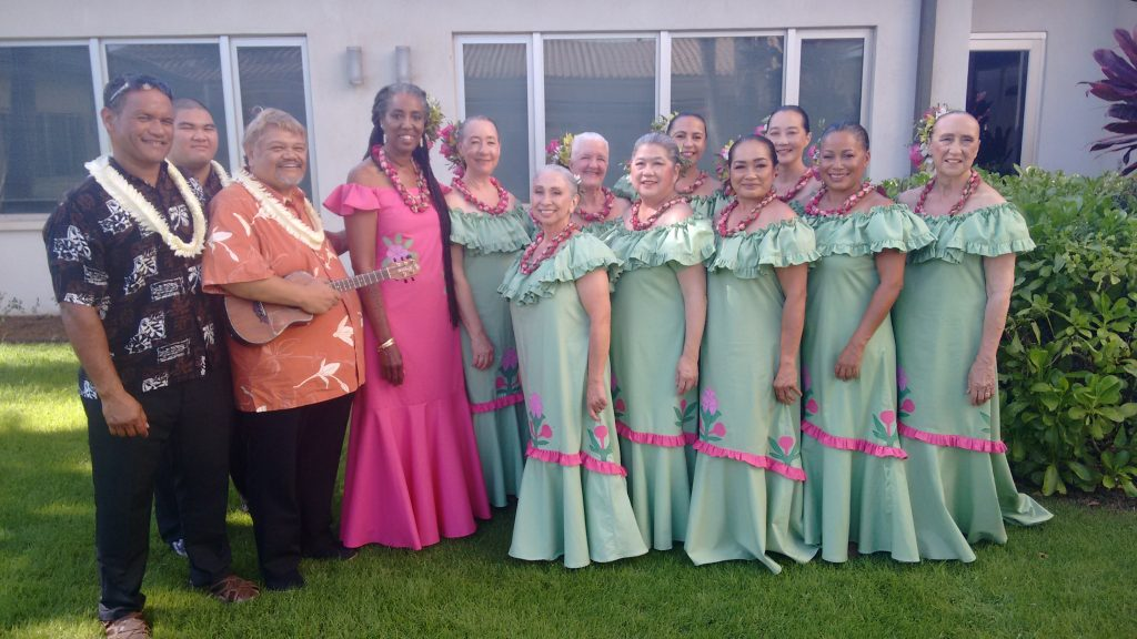 Halau Ka Ua Tuahine group wearing green and pink dresses