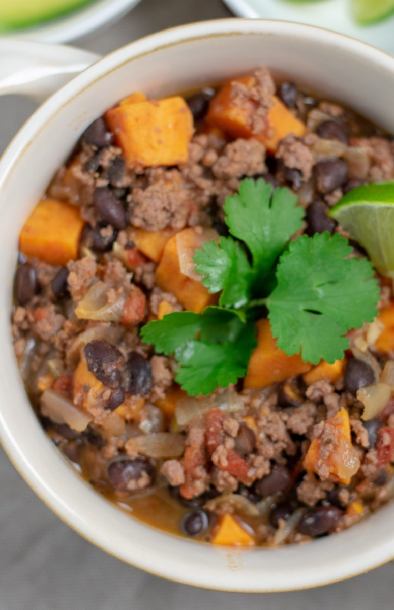 Black Bean Sweet Potato Chili in white bowl overhead close up