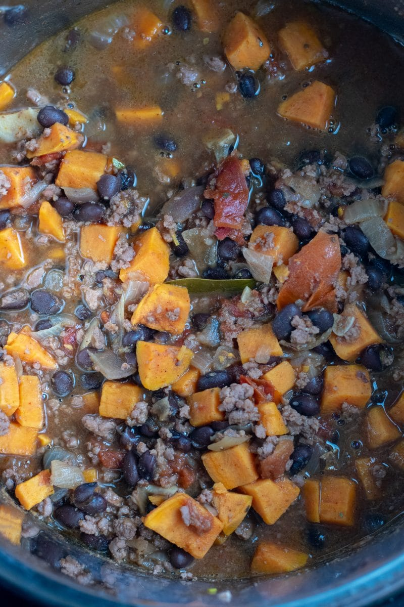 Black Bean Sweet Potato Chili in stock pot overhead view