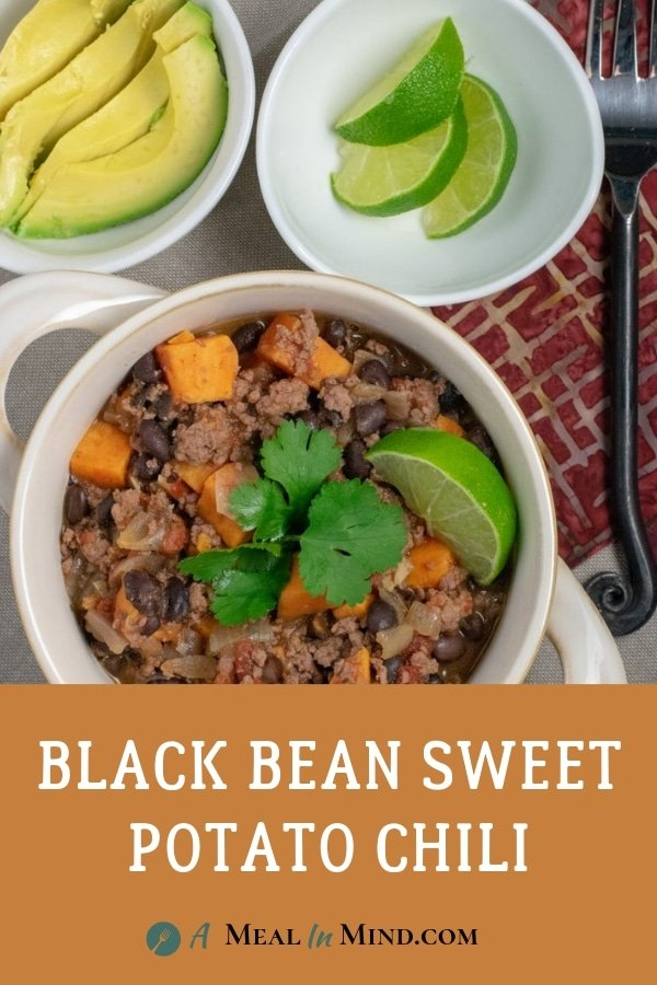 Black Bean Sweet Potato Chili with avo and lime overhead view with fork