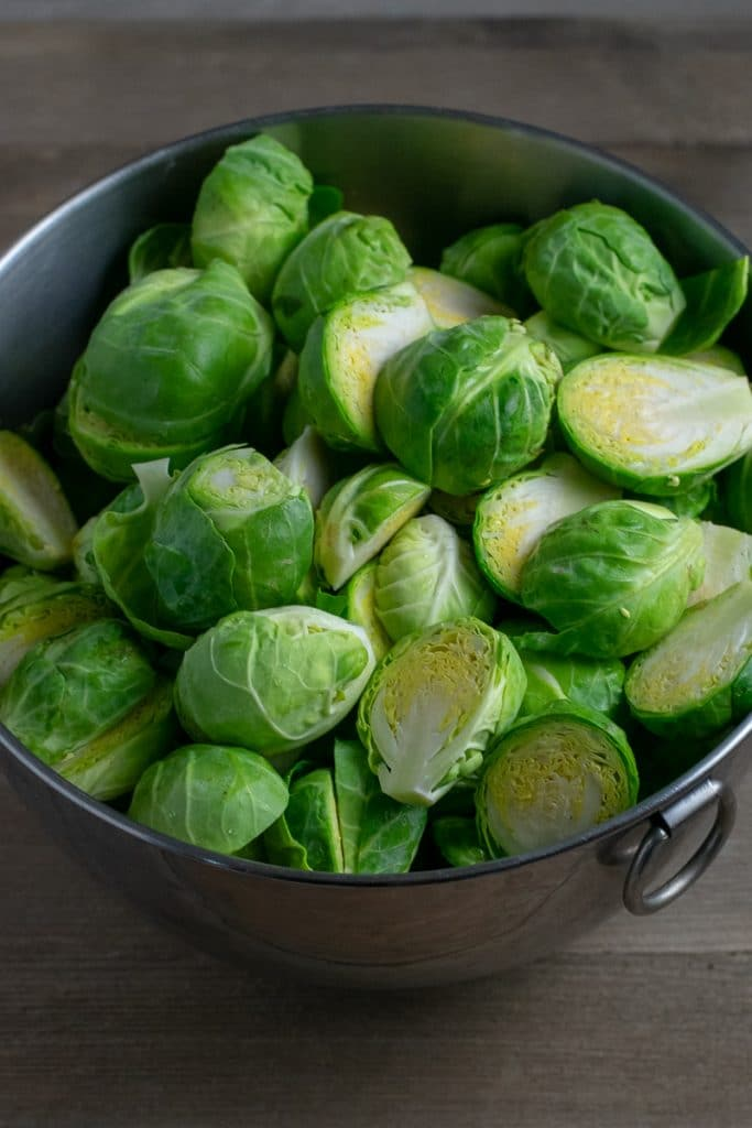 Fresh Brussels sprouts in metal bowl