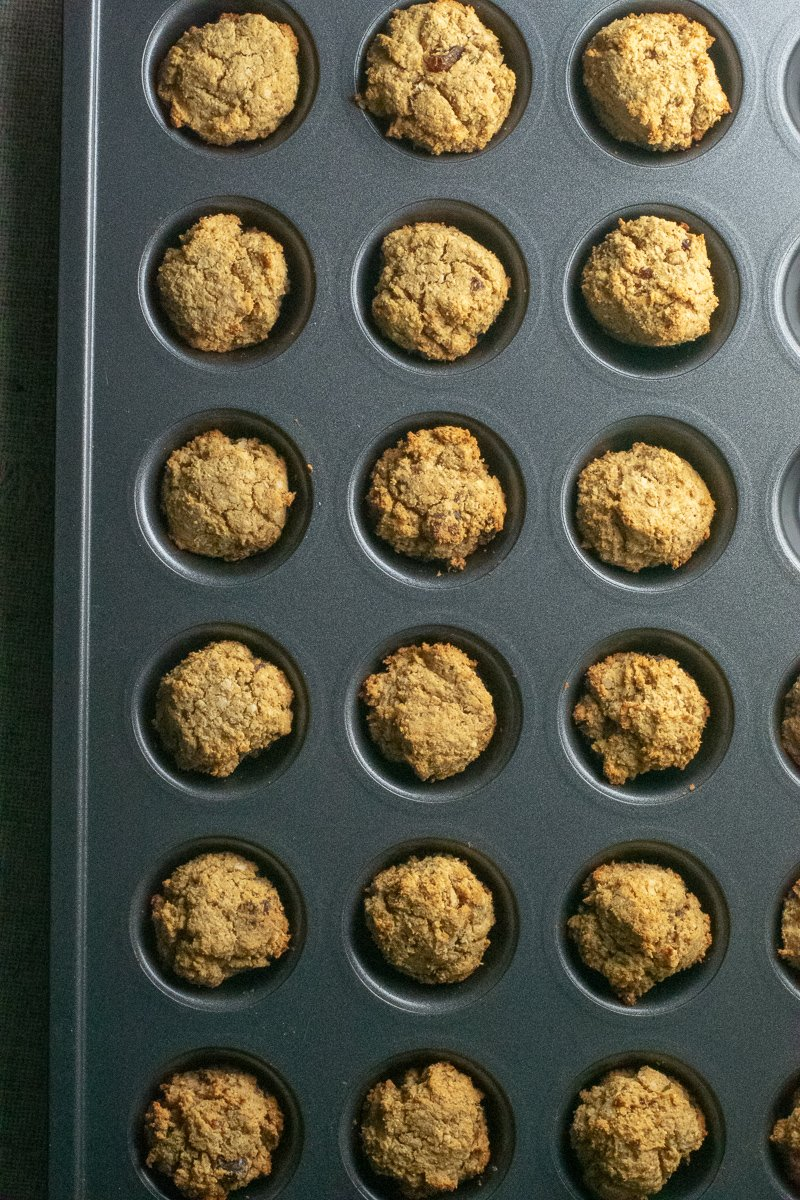 Apple apricot muffins in gray muffin tin