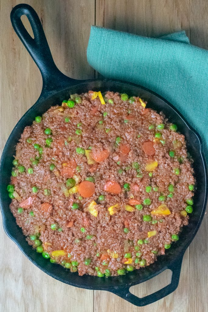 Beef Shepherd's Pie with filling cooked in cast iron pan