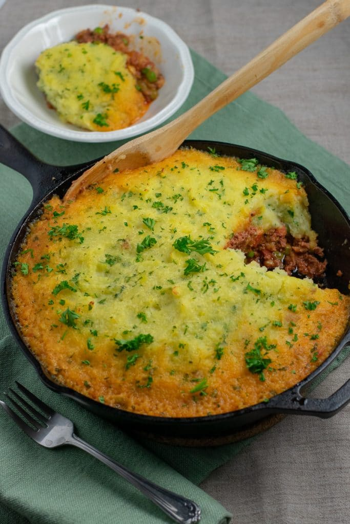 Beef Shepherd's Pie in cast iron skillet partly served