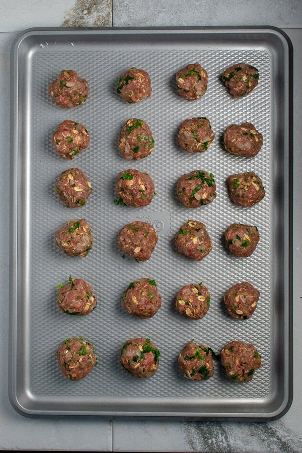 Beef spinach meatballs on baking pan overhead view