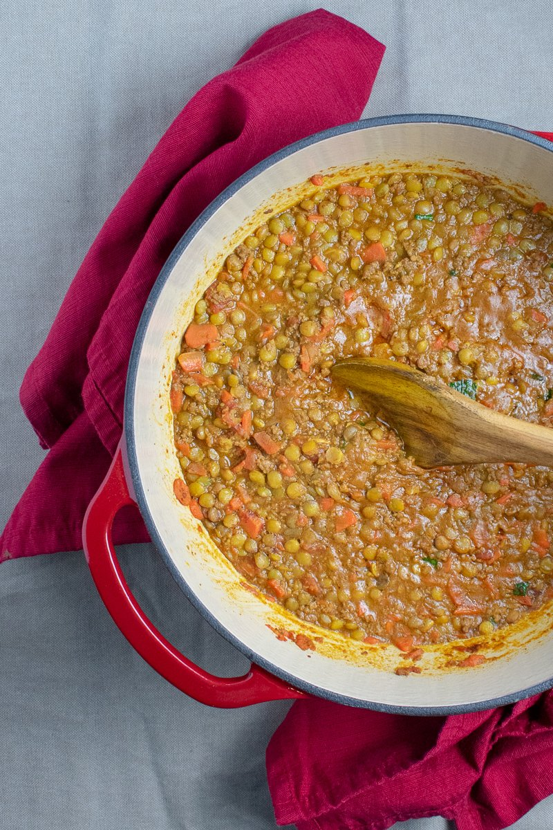 Spiced Lentils with Beef in red dutch oven