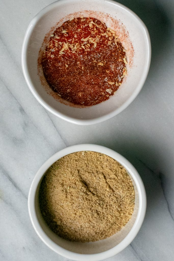 Gluten-free taco seasonings in white bowls