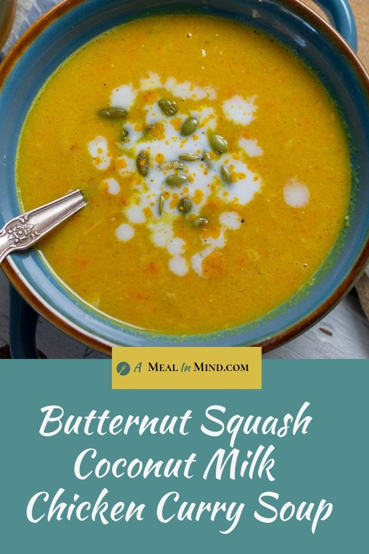 butternut squash coconut curry soup in blue bowl with spoon