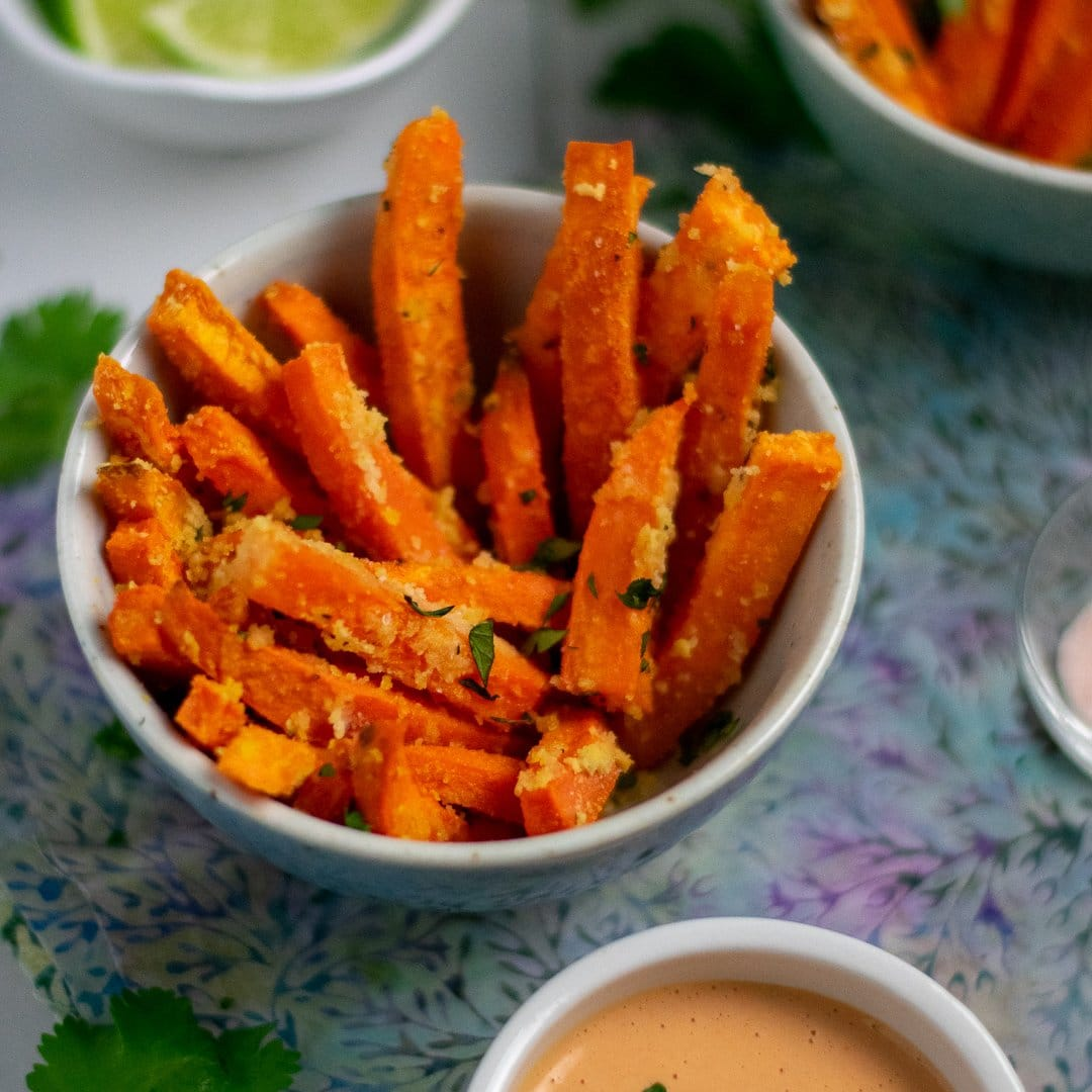 sweet potato fries in small bowl with mayo and limes sq