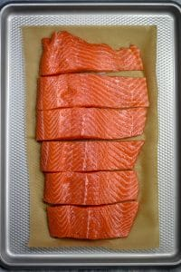 sliced steelhead trout fillet on baking pan