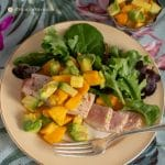 seared opah with papaya-avocado salsa on china plate