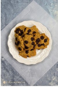 almond flour dark chocolate chip cookies on white plate overhead view