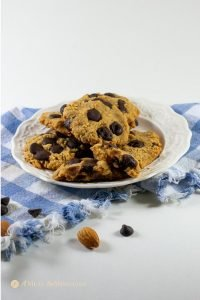 almond flour dark chocolate chip cookies flax egg side view on white plate