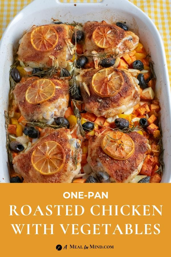 roasted chicken thighs with lemon slices on top of a bed of vegetables in white baking dish