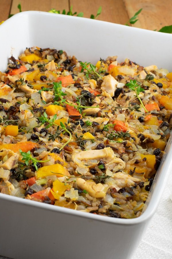 butternut squash chicken rice bake in white ceramic casserole side view