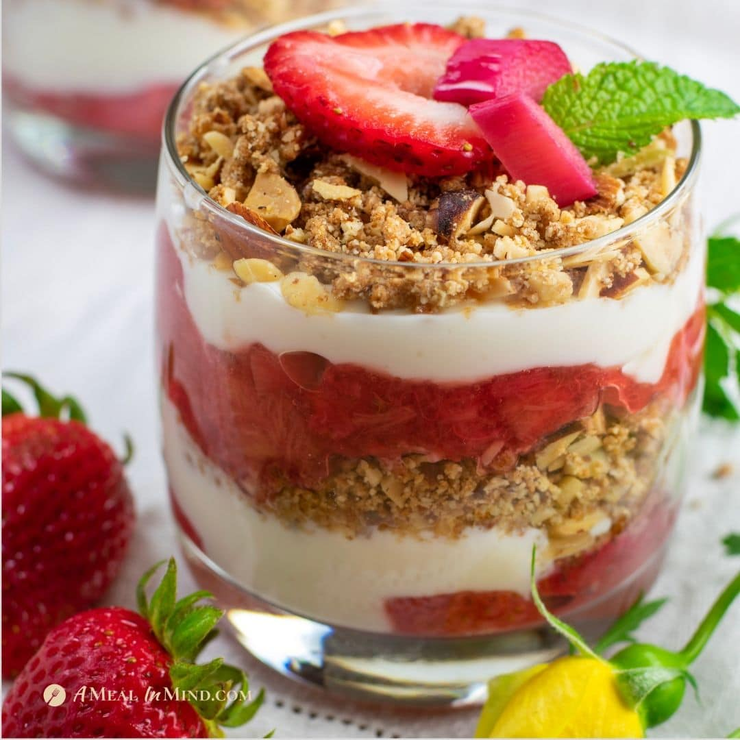 strawberry rhubarb mint parfaits in glass from side