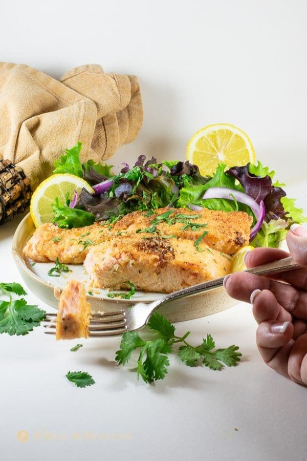delicious almond flour crusted salmon on plate with napkin