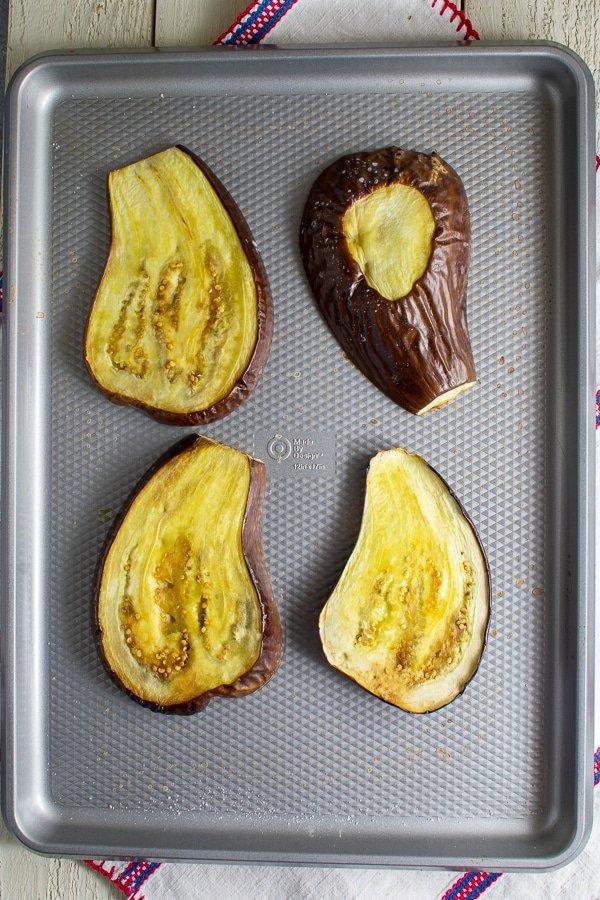 roasted eggplant on rimmed baking sheet