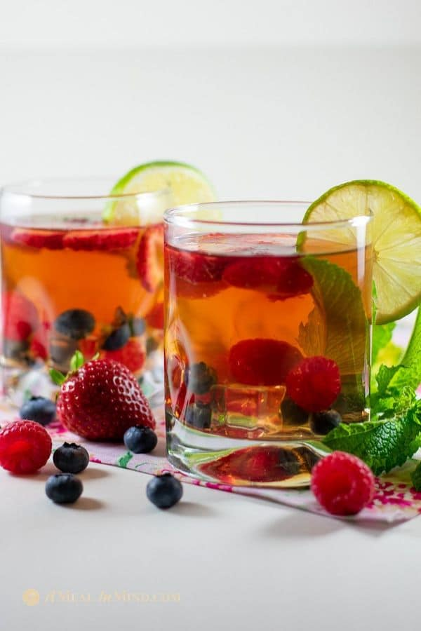 fruit infused herbal tea with fruit garnishes