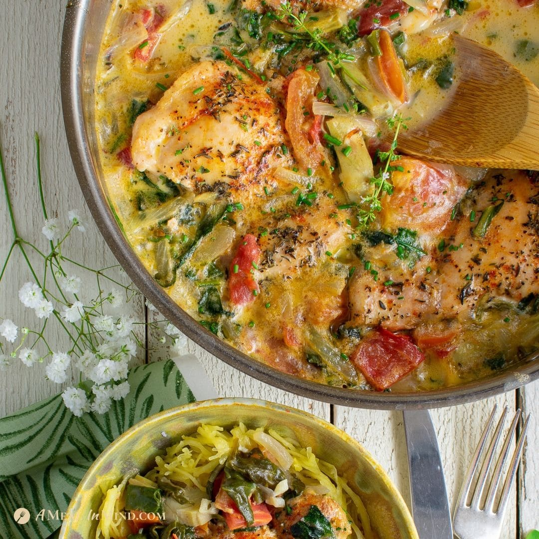 Tuscan chicken with spinach, tomatoes and artichokes