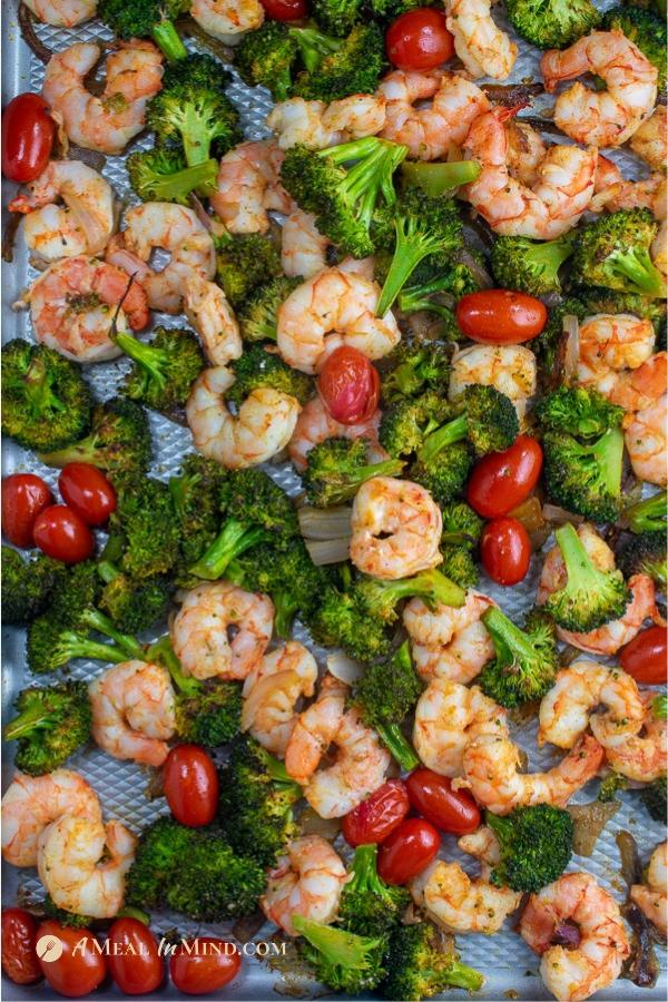savory roasted shrimp with broccoli and tomatoes on sheet pan