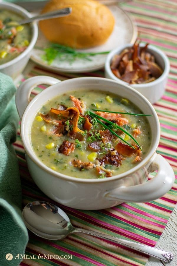delicious almond-crusted salmon chowder in white bowl
