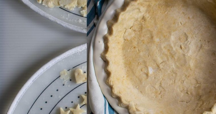 coconut oil pie crust in pan with pastry bag behind