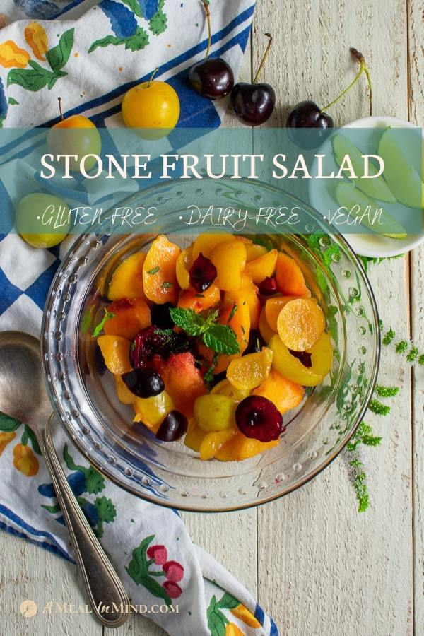 savory stone fruit salad in glass bowl on flowered towel pinterest image