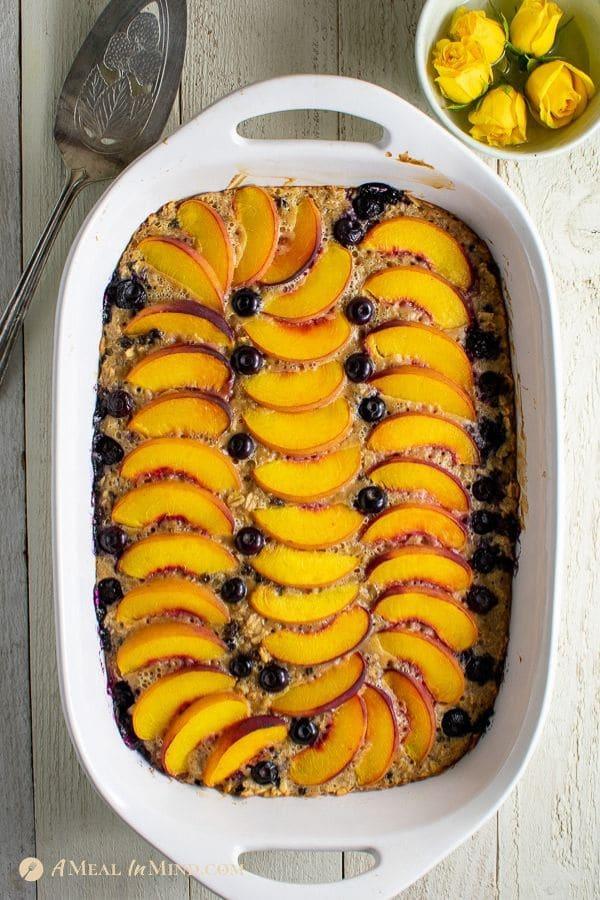 Beautiful Peach Oatmeal Breakfast Clafoutis in baking dish