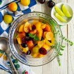 refreshing stone fruit salad in glass bowl
