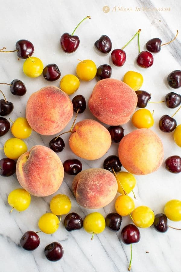 peaches, plums and cherries for stone fruit salad with citrus dressing