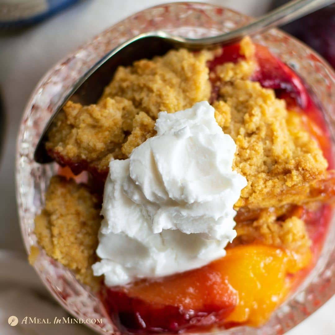 close-up of mouthwatering peach-plum cobbler in glass dishes