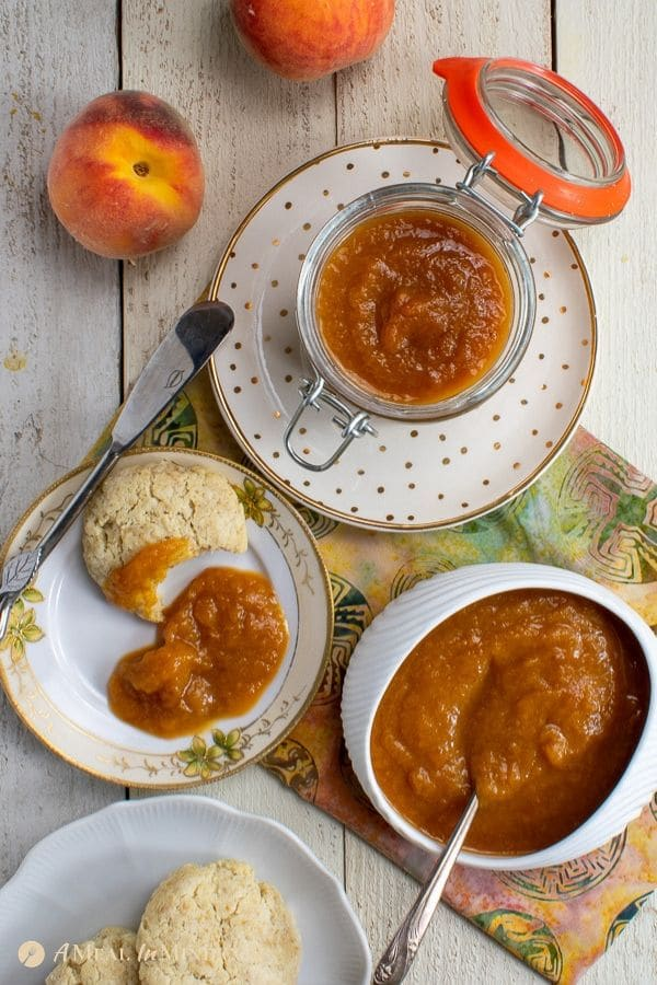 easy peach butter 3 ingredient on white plates with biscuit