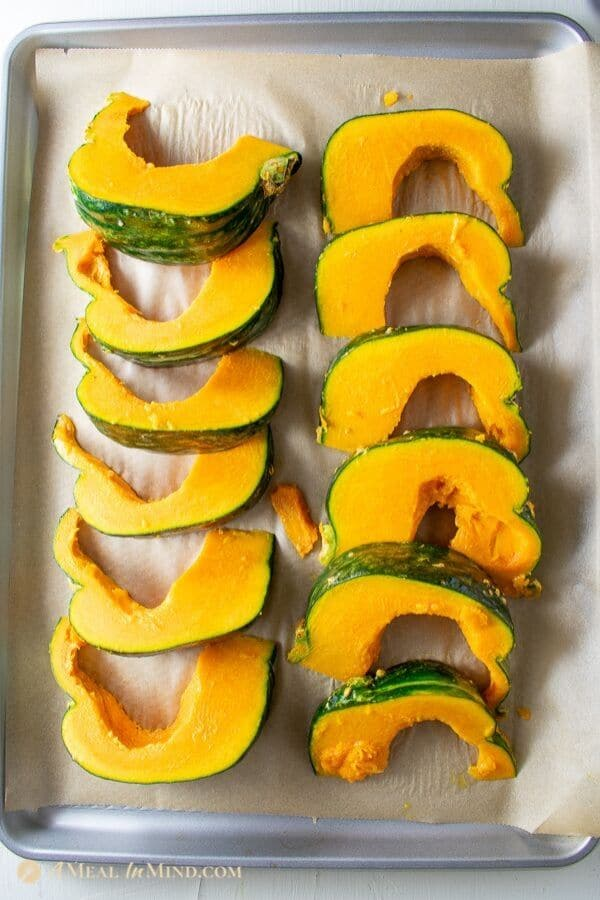roasted kabocha with black sesame not yet baked on baking tray