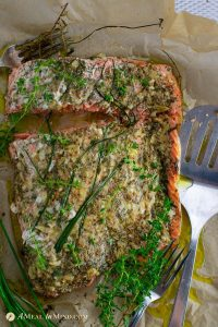 delicious garlic herb salmon baked in parchment overhead view