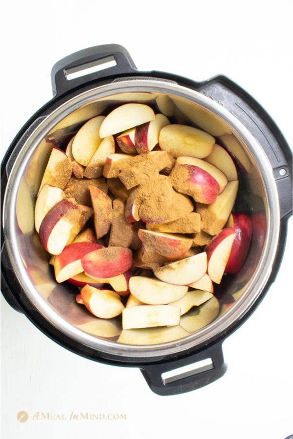 chopped apples and spices in the Instant Pot ready to cook