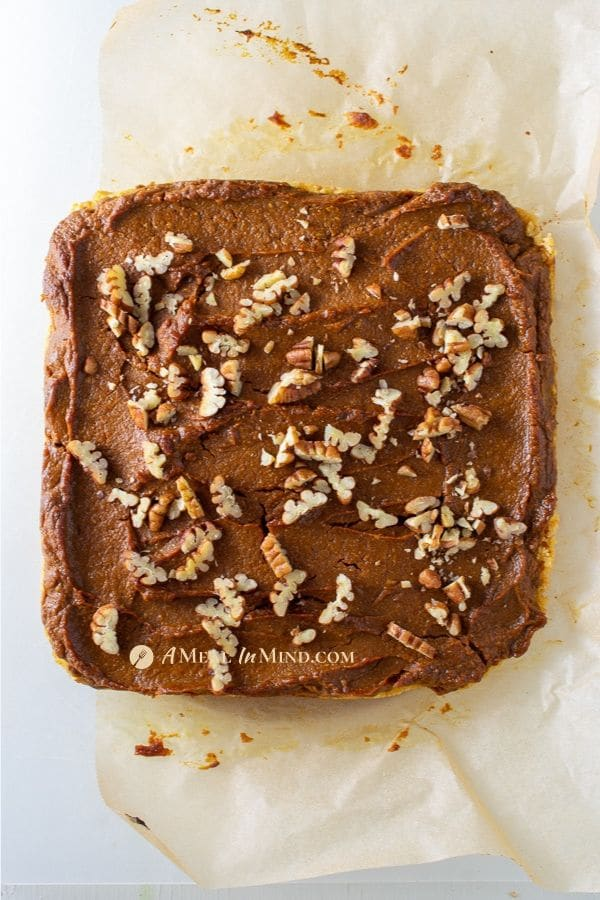 Pumpkin Pie Spice Bars Gluten-Free with pecans on parchment paper