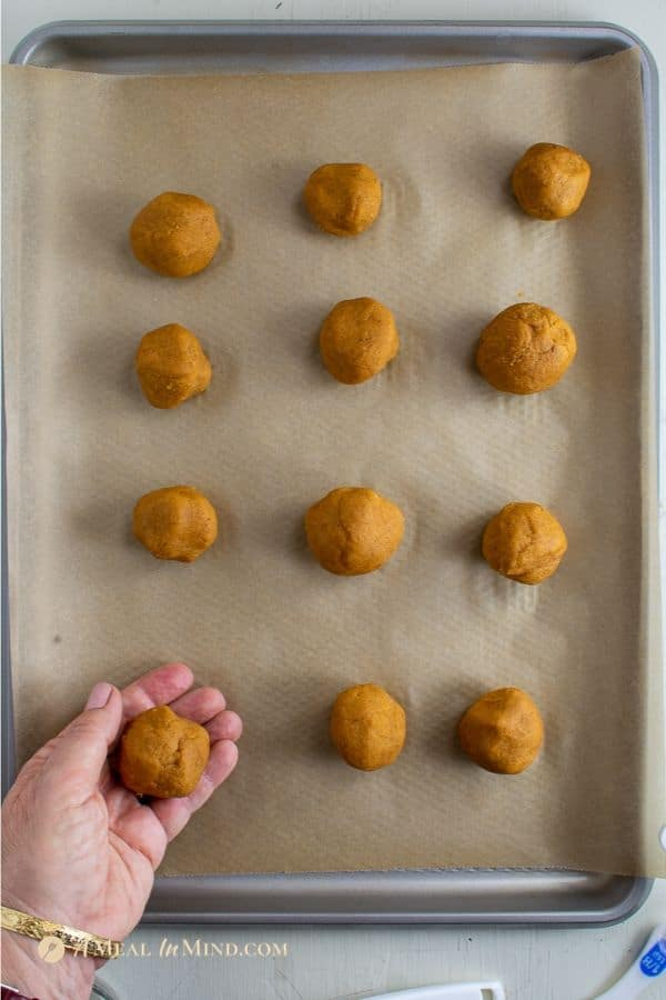 delicious pumpkin cookies with apple butter thumbprint dough in balls
