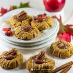 delicious pumpkin cookies with apple butter thumbprint on white plates