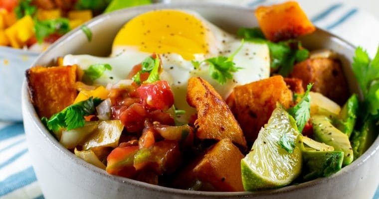 delicious roasted butternut squash hash bowl with egg close up