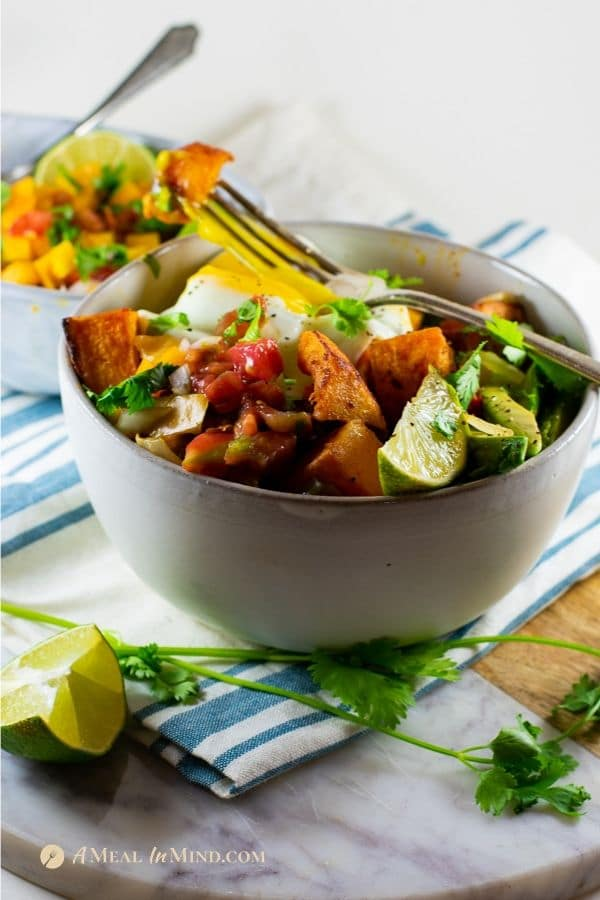 savory roasted butternut squash breakfast hash bowl in white bowls