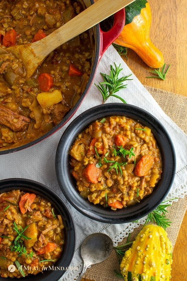 easy beef barley pumpkin stew in black bowls