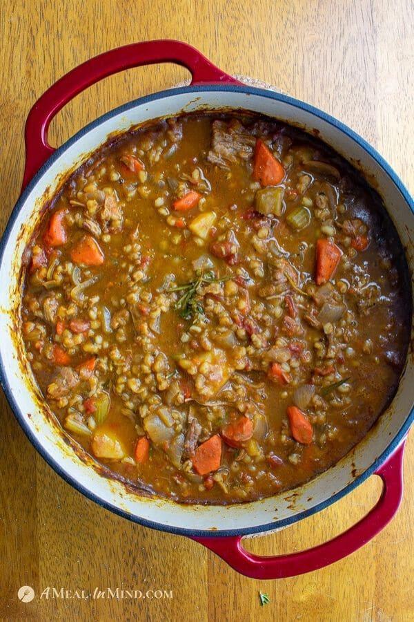 easy beef barley pumpkin stew in lodge dutch oven