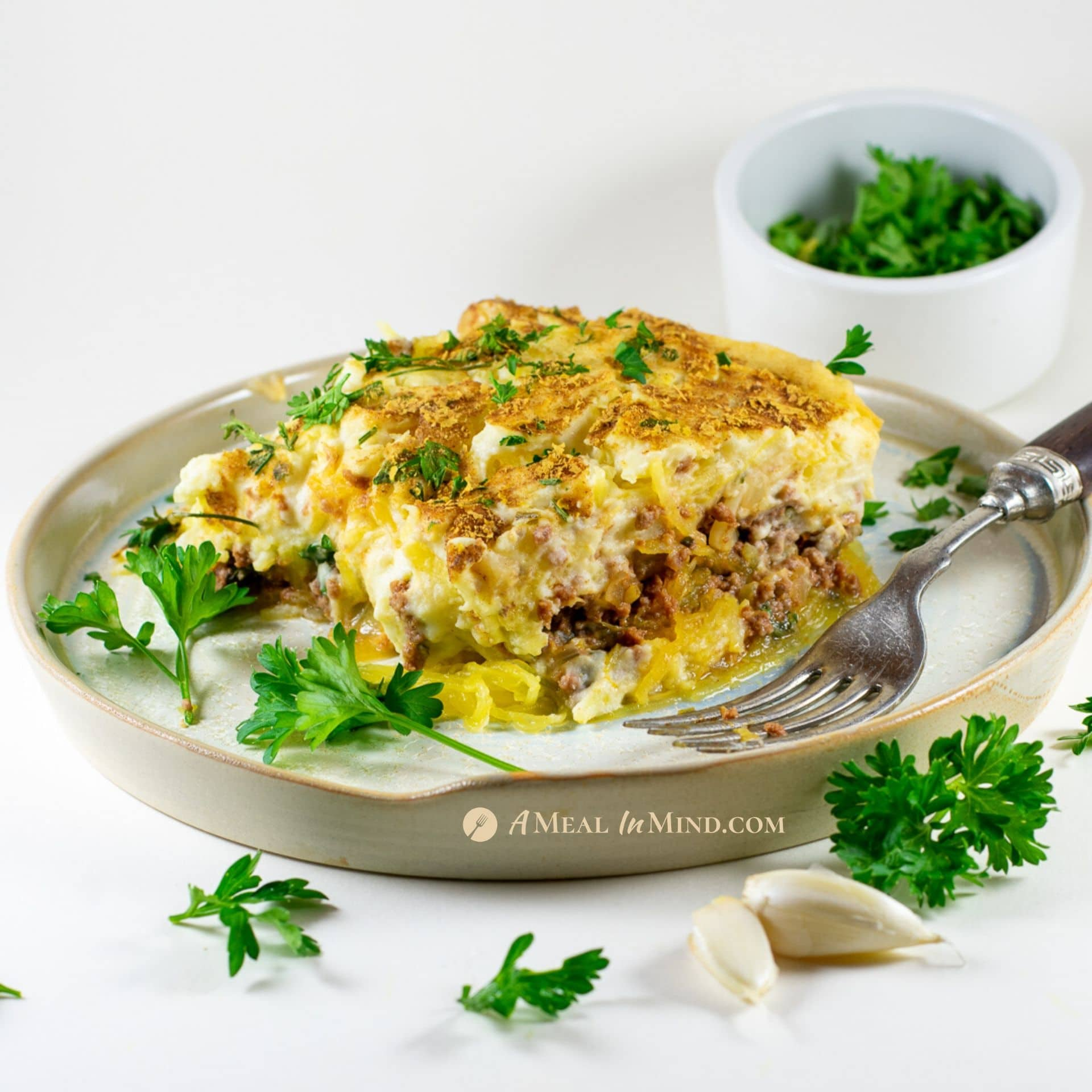 savory gluten-free spaghetti squash Greek pastitsio on white plate