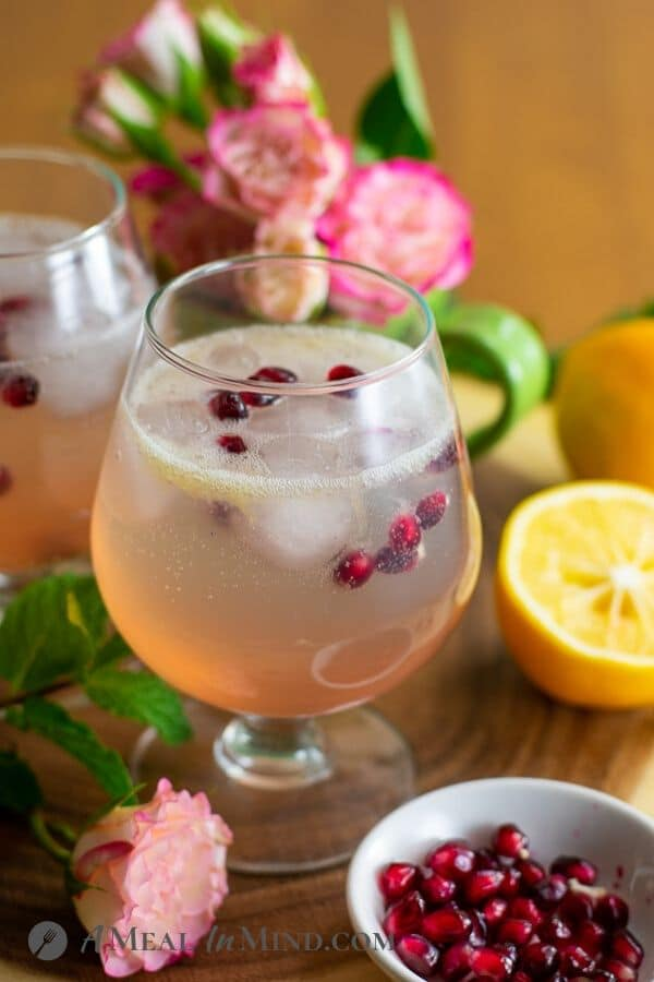 refreshing sparkling meyer lemon mocktail on wood tray