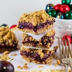 delicious plum-oatmeal crumble bars in a stack with Christmas decorations