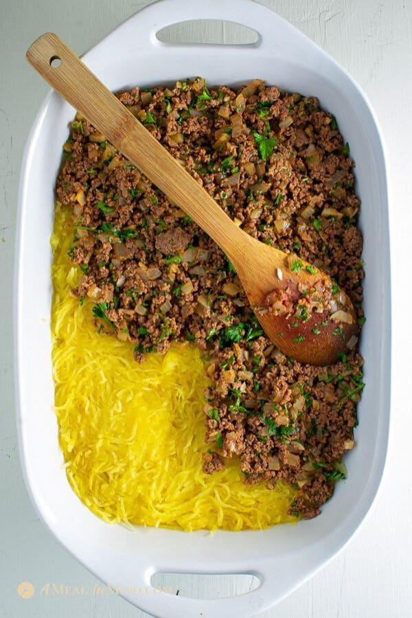 beef filling on gluten-free spaghetti squash Greek pastitsio in baking dish
