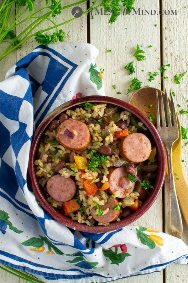 dirty rice vegetable sausage bake overhead view in red bowl