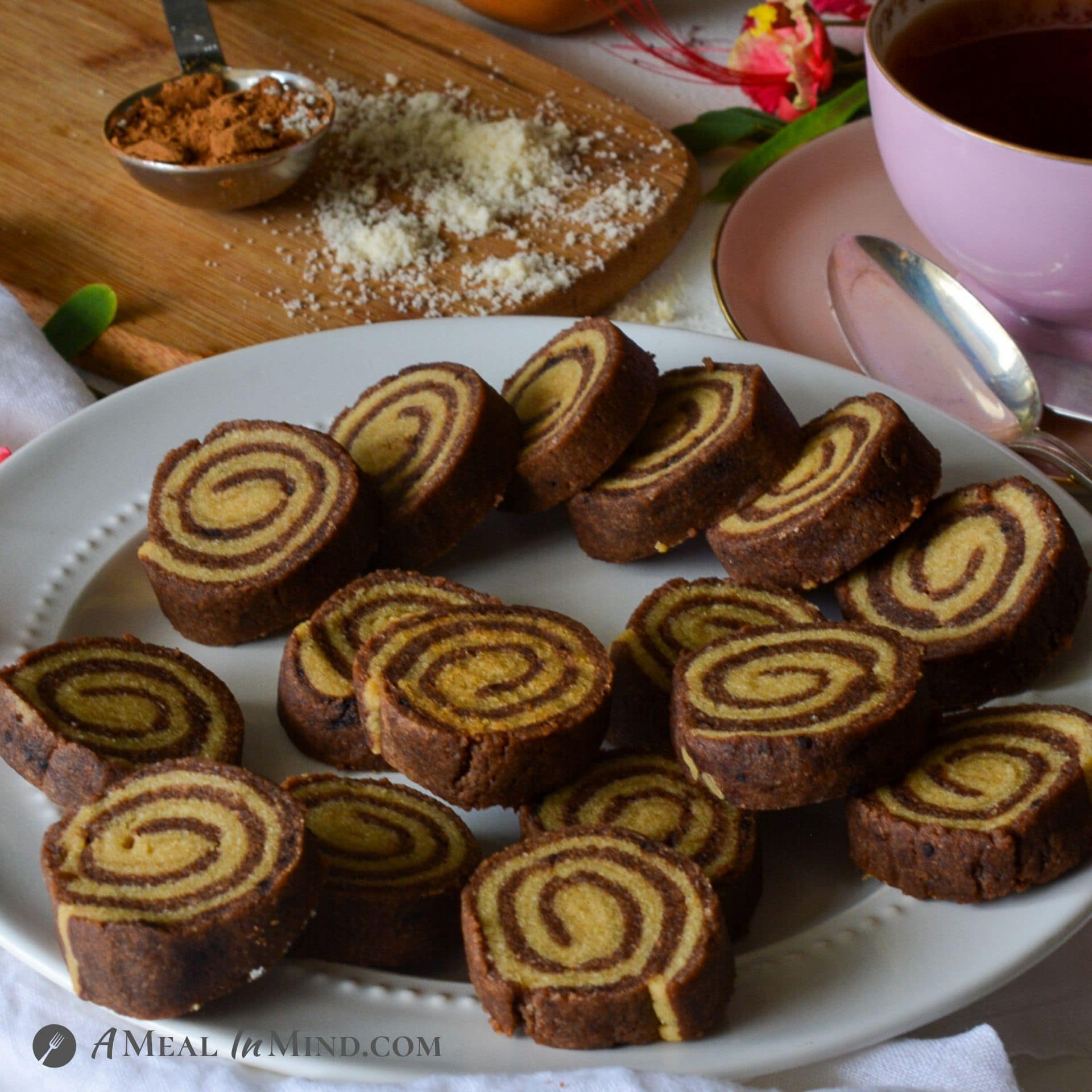 Almond Flour Carob Pinwheel Cookies on white plate with flowers