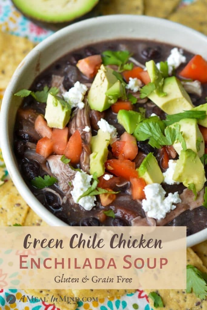Green chile chicken enchilada soup in white bowl pinterest image